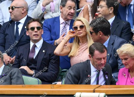 Stock Photo of Sam Claflin, Tess Daly and Vernon Kay on Centre Court