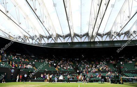 Cori Gauff and Magdalena Rybarikova walk onto Court 1. Before their Ladies' Singles second round match