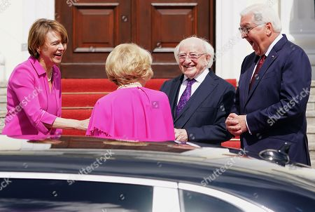 Stock Picture of German President Frank-Walter Steinmeier (R) and his wife Elke Buedenbender (L) welcome Irish President Michael D. Higgins (2-R) and his wife Sabina Higgins (2-L) at Bellevue Palace in Berlin, Germany, 03 July 2019. Irish President Higgins is on a three-days state visit to Germany.