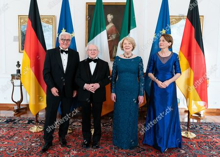 Stock Image of German President Frank-Walter Steinmeier (L) and his wife Elke Buedenbender (R) and Irish President Michael D. Higgins (2-L) and his wife Sabina Higgins (2-R) pose before a gala dinner given by German president at Bellevue Palace in Berlin, Germany, 03 July 2019. Irish President Higgins is on a three-days state visit to Germany.