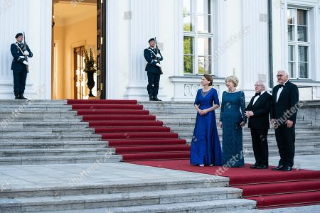 Stock Photo of German President Frank-Walter Steinmeier (R) and his wife Elke Buedenbender (L) welcome Irish President Michael D. Higgins (2-R) and his wife Sabina Higgins (2-L) before a gala dinner given by German president at Bellevue Palace in Berlin, Germany, 03 July 2019. Irish President Higgins is on a three-days state visit to Germany.