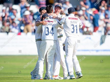 Yorkshire's Duanne Olivier is congratulated on taking the final wicket of Surrey's Gareth Batty to seal victory for his side.