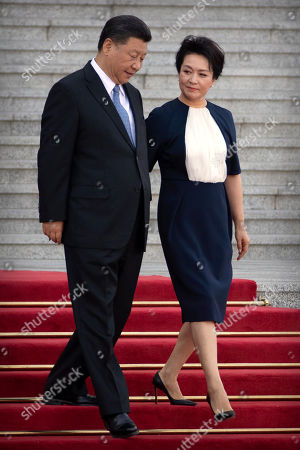 Stock Image of Xi Jinping, Peng Liyuan. Chinese President Xi Jinping and his wife Peng Liyuan arrive for a welcome ceremony with Bulgarian President Rumen Radev at the Great Hall of the People in Beijing