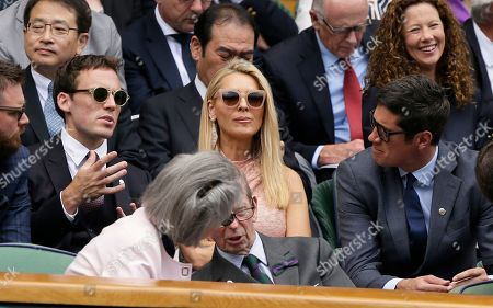 Actor Sam Claflin, TV presenters Tess Daly and her husband Vernon Kay, from left, take their seats in the Royal Box on Center Court during day three of the Wimbledon Tennis Championships in London