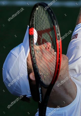 South Africa's Kevin Anderson serves to Serbia's Janko Tipsarevic in a Men's singles match during day three of the Wimbledon Tennis Championships in London