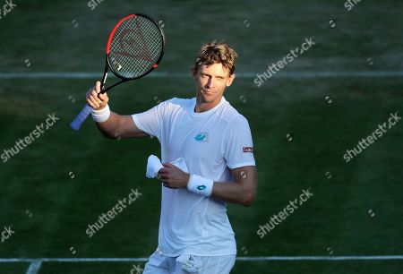 South Africa's Kevin Anderson celebrates after beating Serbia's Janko Tipsarevic in a Men's singles match during day three of the Wimbledon Tennis Championships in London