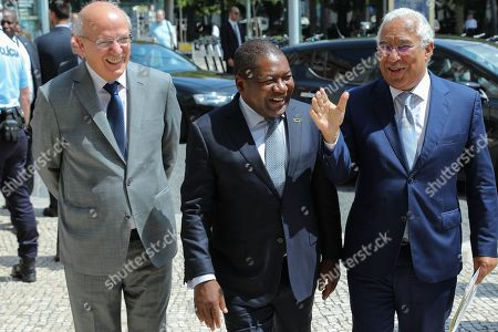 Mozambique's President Filipe Nyusi (C) and Portugal's Prime Minister Antonio Costa (R) accompanied by Portugal's Foreigner Affairs Minister Augusto Santos Silva (L) at their arrival for the IV Portugal - Mozambique summit at Foz Palace in Lisbon, Portugal, 03 July 2019. Mozambique President, Filipe Nyusi is on a four-day official visit to Portugal.