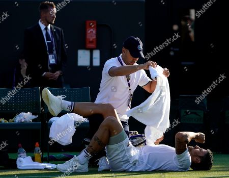 Janko Tipsarevic of Serbia receives medical treatment during his second round match against Kevin Anderson of South Africa for the Wimbledon Championships at the All England Lawn Tennis Club, in London, Britain, 03 July 2019.