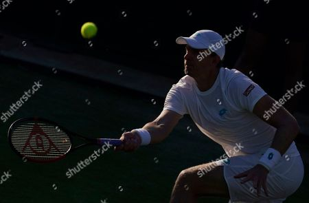 Stock Picture of Kevin Anderson of South Africa in action against Janko Tipsarevic of Serbia in their second round match during the Wimbledon Championships at the All England Lawn Tennis Club, in London, Britain, 03 July 2019.