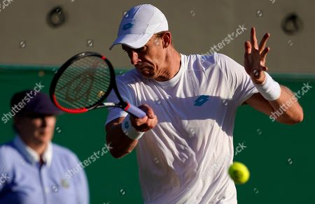 Stock Image of Kevin Anderson of South Africa in action against Janko Tipsarevic of Serbia in their second round match during the Wimbledon Championships at the All England Lawn Tennis Club, in London, Britain, 03 July 2019.