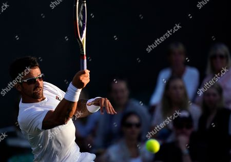 Janko Tipsarevic of Serbia in action against Kevin Anderson of South Africa in their second round match during the Wimbledon Championships at the All England Lawn Tennis Club, in London, Britain, 03 July 2019.