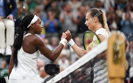 Cori Gauff of the US (L) at the net with Magdalena Rybarikova of Slovakia whom she defeated in their second round match during the Wimbledon Championships at the All England Lawn Tennis Club, in London, Britain, 03 July 2019.