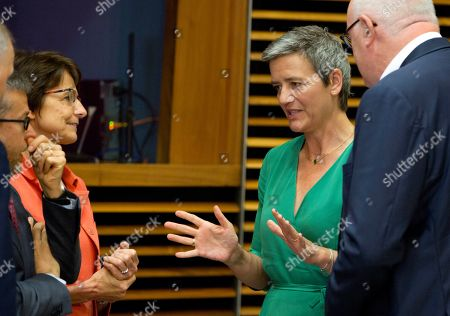 European Commissioner for Competition Margrethe Vestager, second right, speaks with European Commissioner for Employment and Social Affairs Marianne Thyssen, third left, during the weekly college meeting at EU headquarters in Brussels