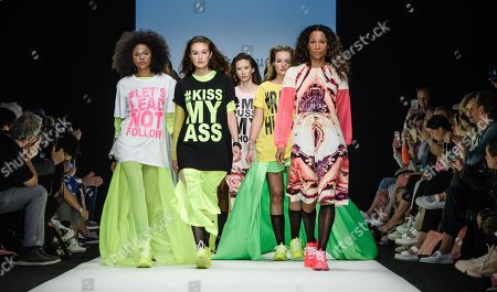 Models around actress Annabelle Mandeng (R) present creations by Austrian designer Rebekka Ruetz during the Mercedes-Benz Fashion Week in Berlin, Germany, 03 July 2019. The Spring/Summer 2020 collections are presented at the MBFW Berlin from 01 to 03 July.