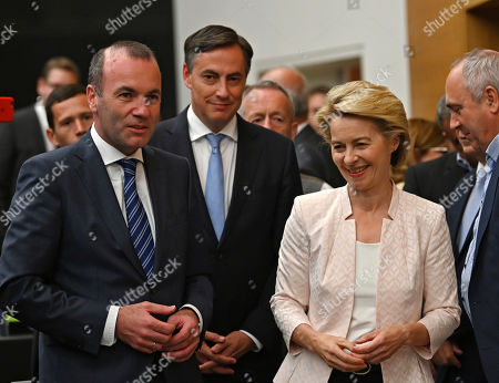 Chairman of the EPP Group in the European Parliament Manfred Weber (L) waits with German Defense Minister Ursula von der Leyen (R) and MEP David McAllister (C) for the beginning of an EPP faction meeting at the European Parliament, in Strasbourg, France, 03 July 2019. German Defence Minister von der Leyen was unexpectedly put forward as candidate for the European Commission president on 02 July 2019. The European Parliament has to approve the candidates for the four EU top jobs.