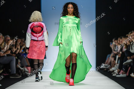 German actress Annabelle Mandeng (R) presents a creation by Austrian designer Rebekka Ruetz during the Mercedes-Benz Fashion Week in Berlin, Germany, 03 July 2019. The Spring/Summer 2020 collections are presented at the MBFW Berlin from 01 to 03 July.
