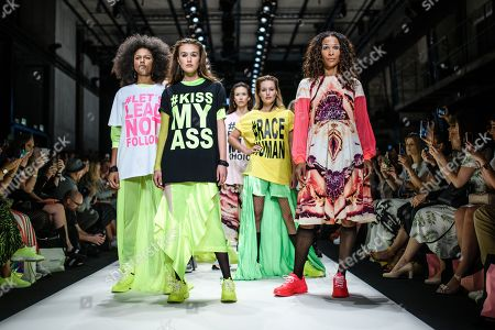 German actress Annabelle Mandeng (R) and models present creations by Austrian designer Rebekka Ruetz during the Mercedes-Benz Fashion Week in Berlin, Germany, 03 July 2019. The Spring/Summer 2020 collections are presented at the MBFW Berlin from 01 to 03 July.