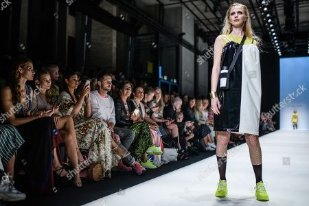 Stock Photo of A model presents a creation by Austrian designer Rebekka Ruetz during the Mercedes-Benz Fashion Week in Berlin, Germany, 03 July 2019. The Spring/Summer 2020 collections are presented at the MBFW Berlin from 01 to 03 July.