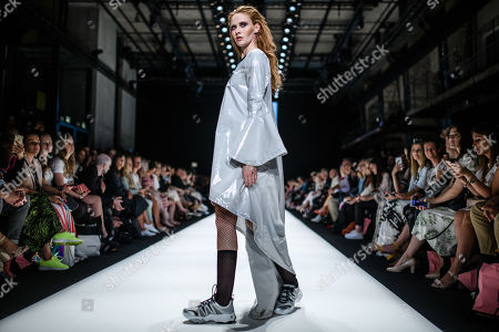 Stock Image of A model presents a creation by Austrian designer Rebekka Ruetz during the Mercedes-Benz Fashion Week in Berlin, Germany, 03 July 2019. The Spring/Summer 2020 collections are presented at the MBFW Berlin from 01 to 03 July.