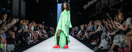 German actress Annabelle Mandeng presents a creation by Austrian designer Rebekka Ruetz during the Mercedes-Benz Fashion Week in Berlin, Germany, 03 July 2019. The Spring/Summer 2020 collections are presented at the MBFW Berlin from 01 to 03 July.