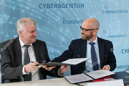 German Minister of Interior, Construction and Homeland Horst Seehofer (L) and Parliamentary Secretary of State at the Federal Ministry of Defense Peter Tauber (R) sign a letter of intent to found the Cyber Agency of the Federal Republic of Germany in Schkeuditz, Germany, 03 July 2019. The Cyber Agency is a building block of the Federal Government to protect the citizens of the country in cyberspace. The Agenur is to have its permanent seat at Leipzig-Halle Airport.
