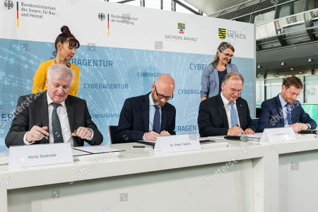 (L-R) German Minister of Interior, Construction and Homeland Horst Seehofer, Parliamentary Secretary of State at the Federal Ministry of Defense Peter Tauber, Premier of Saxony-Anhalt Reiner Haseloff and Saxony Prime Minister Michael Kretschmer, sign a letter of intent to found the Cyber Agency of the Federal Republic of Germany in Schkeuditz, Germany, 03 July 2019. The Cyber Agency is a building block of the Federal Government to protect the citizens of the country in cyberspace. The Agenur is to have its permanent seat at Leipzig-Halle Airport.