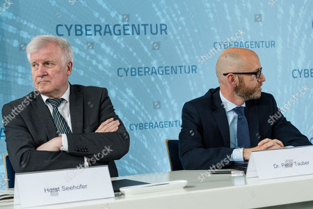 German Minister of Interior, Construction and Homeland Horst Seehofer (L) and Parliamentary Secretary of State at the Federal Ministry of Defense Peter Tauber (R) while signing a letter of intent to found the Cyber Agency of the Federal Republic of Germany in Schkeuditz, Germany, 03 July 2019. The Cyber Agency is a building block of the Federal Government to protect the citizens of the country in cyberspace. The Agenur is to have its permanent seat at Leipzig-Halle Airport.