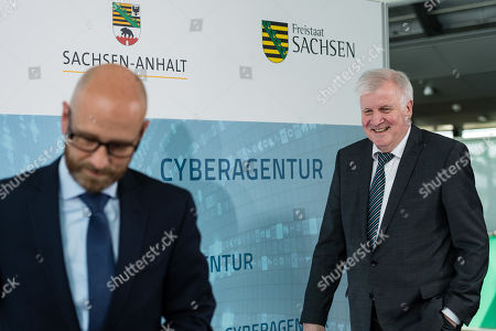 German Minister of Interior, Construction and Homeland Horst Seehofer (R) and Parliamentary Secretary of State at the Federal Ministry of Defense Peter Tauber (L) while signing a letter of intent to found the Cyber Agency of the Federal Republic of Germany in Schkeuditz, Germany, 03 July 2019. The Cyber Agency is a building block of the Federal Government to protect the citizens of the country in cyberspace. The Agenur is to have its permanent seat at Leipzig-Halle Airport.