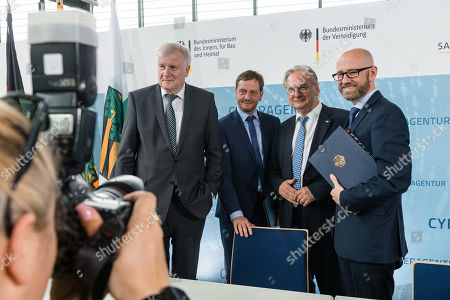 (L-R) German Minister of Interior, Construction and Homeland Horst Seehofer, Saxony Prime Minister Michael Kretschmer, Premier of Saxony-Anhalt Reiner Haseloff and Parliamentary Secretary of State at the Federal Ministry of Defense Peter Tauber sign a letter of intent to found the Cyber Agency of the Federal Republic of Germany in Schkeuditz, Germany, 03 July 2019. The Cyber Agency is a building block of the Federal Government to protect the citizens of the country in cyberspace. The Agenur is to have its permanent seat at Leipzig-Halle Airport.