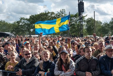 The audience listens to Swedish singer Silvana Imam (unseen) during her opening act on the Orange stage at Roskilde Festival, in Roskilde, Denmark, 03 July 2019. The festival runs from 29 June to 06 July.