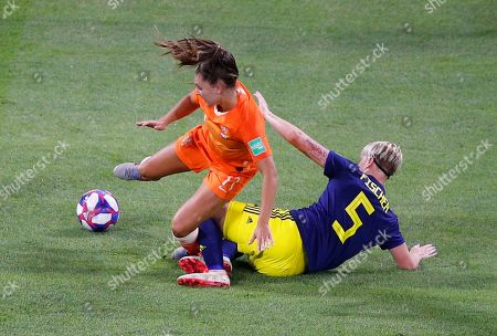 Netherlands' Lieke Martens, left, is tackled by Sweden's Nilla Fischer during the Women's World Cup semifinal soccer match between the Netherlands and Sweden, at the Stade de Lyon outside Lyon, France