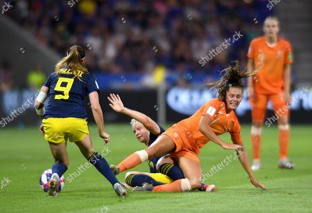 Lieke Martens of Netherlands is tackled by Nilla Fischer of Sweden
