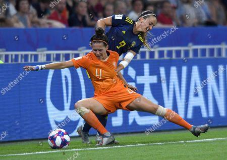 Merel Van Dongen of Netherlands and Kosovare Asllani of Sweden in action