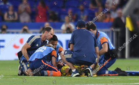 Kosovare Asllani of Sweden receives treatment for an injury that causes a significant delay at the end of extra time
