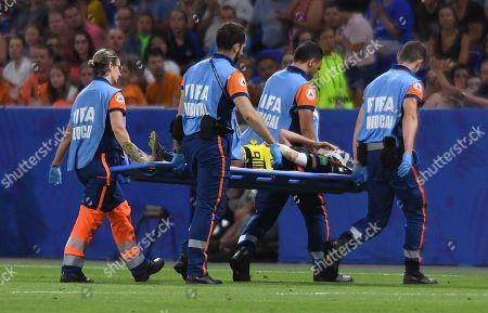Kosovare Asllani of Sweden is stretchered off injured at the end of extra time