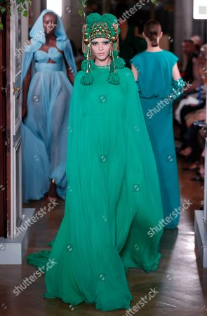 Italian model Mariacarla Boscono presents a creation from the Fall/Winter 2019/20 Haute Couture collection by Italian fashion designer Pierpaolo Piccioli for Valentino fashion house during the Paris Fashion Week, in Paris, France, 03 July 2019. The presentation of the Haute Couture collections runs from 30 June to 04 July.