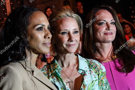 US actress Anne Heche (C), Barbara Becker (L) and Natalia Woerner (R) pose prior to the Riani show during the Mercedes-Benz Fashion Week in Berlin, Germany, 03 July 2019. The Spring/Summer 2020 collections are presented at the MBFW Berlin from 01 to 03 July.