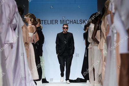 Stock Photo of German designer Michael Michalsky (C) appears on the catwalk at the end of his Atelier Michalsky show during the Mercedes-Benz Fashion Week in Berlin, Germany, 03 July 2019. The Spring/Summer 2020 collections are presented at the MBFW Berlin from 01 to 03 July.