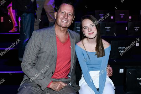 US Ambassador to Germany Rich Williams Grenell (L) and the niece of his partner Matt Lashey (not pictured) attend the Atelier Michalsky show during the Mercedes-Benz Fashion Week in Berlin, Germany, 03 July 2019. The Spring/Summer 2020 collections are presented at the MBFW Berlin from 01 to 03 July.