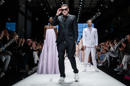German designer Michael Michalsky (C) appears on the catwalk at the end of his Atelier Michalsky show during the Mercedes-Benz Fashion Week in Berlin, Germany, 03 July 2019. The Spring/Summer 2020 collections are presented at the MBFW Berlin from 01 to 03 July.