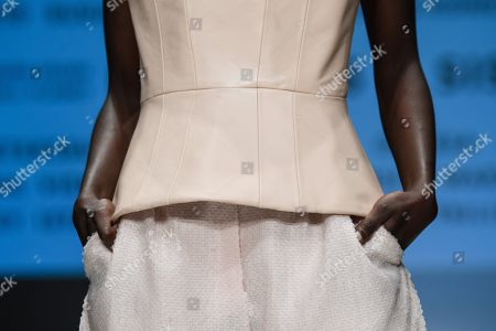 Stock Picture of A model presents a creation by German designer Michael Michalsky for his Atelier Michalsky show during the Mercedes-Benz Fashion Week in Berlin, Germany, 03 July 2019. The Spring/Summer 2020 collections are presented at the MBFW Berlin from 01 to 03 July.