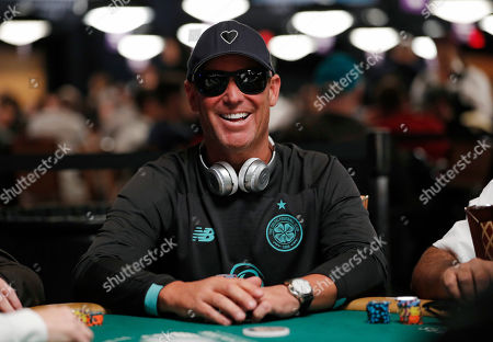 Former Australian cricket player Shane Warne plays during the first day of the World Series of Poker main event, in Las Vegas