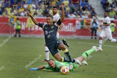 Antonio Lopez, Marcos Diaz. Club America midfielder Antonio Lopez (23), top, trips over Boca Juniors goalkeeper Marcos Diaz (12) during the first half of a Colossus Cup soccer match in Harrison, N.J
