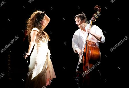 Silvia Perez Cruz (L), accompanied by double-bass player Javier Colina (R), performs on stage during her Granada's Music and Dance International Festival concert played at La Alhambra's Carlos V Palace in Granada, southern Spain, 03 July 2019.