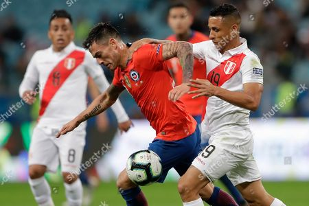 Stock Picture of Chile's Charles Aranguiz, left, vies for the ball with Peru's Victor Yotun during a Copa America semifinal soccer match at the Arena do Gremio in Porto Alegre, Brazil