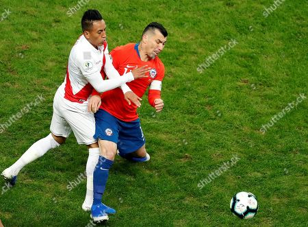 Stock Picture of Gary Medel (R) of Chile vies for the ball against Christian Cuevas (L) of Peru during the Copa America 2019 semi-finals soccer match between Chile and Peru, at Arena do Gremio Stadium in Porto Alegre, Brazil, 03 July 2019.