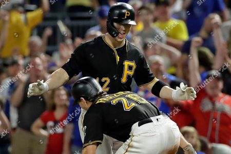 Corey Dickerson, Adam Frazier. Pittsburgh Pirates' Corey Dickerson, top, celebrates with Adam Frazier (26) after driving in the game-winning run with a sacrifice fly off Chicago Cubs relief pitcher Craig Kimbrel in a baseball game in Pittsburgh, . The Pirates won 6-5