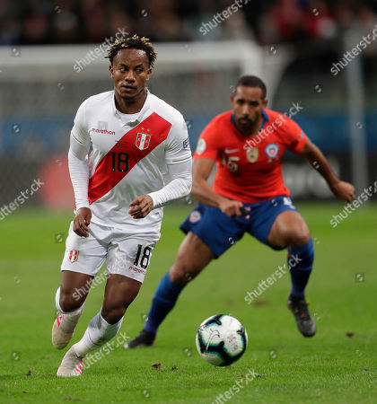 Stock Photo of Peru's Andre Carrillo, front, goes for the ball followed by Chile's Jean Beausejour during a Copa America semifinal soccer match at the Arena do Gremio in Porto Alegre, Brazil
