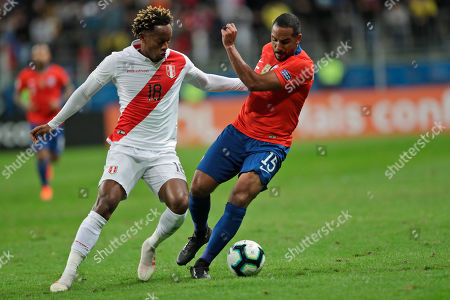 Peru's Andre Carrillo, left, and Chile's Jean Beausejour compete for the ball during a Copa America semifinal soccer match at the Arena do Gremio in Porto Alegre, Brazil