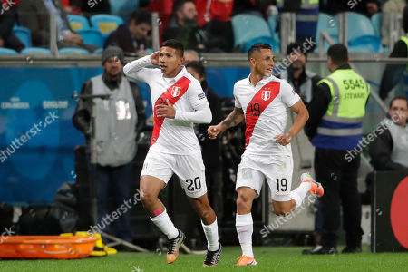 Peru's Edison Flores, left, celebrates scoring his side's first goal with teammate Victor Yotun during a Copa America semifinal soccer match at the Arena do Gremio in Porto Alegre, Brazil